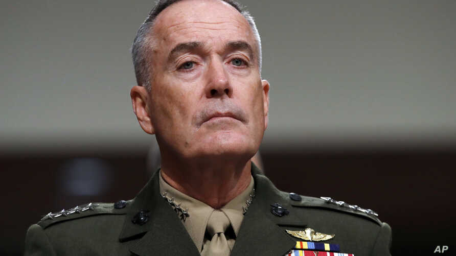 FILE - Joint Chiefs Chairman Gen. Joseph Dunford on Capitol Hill in Washington, June 13, 2017. Military chiefs will seek a six-month delay before letting transgender people enlist in their services, officials said June 23. Dunford told a Senate commi...