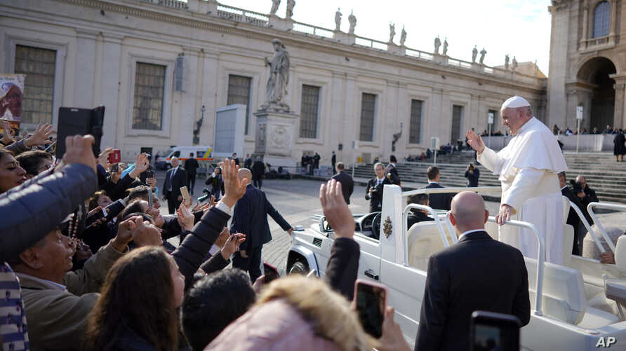 Pope Francis leaves at the end of his weekly general audience, in St. Peter's square, at the Vatican, Nov. 21, 2018.