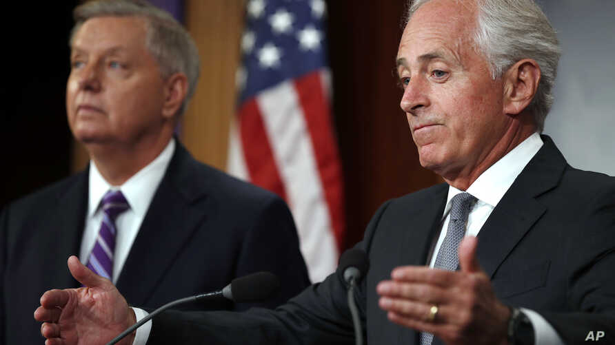 Sen. Bob Corker, R-Tenn., right, with Sen. Lindsey Graham, R-S.C., speaks at a news conference about efforts to end modern slavery, Sept. 14, 2017, on Capitol Hill in Washington.