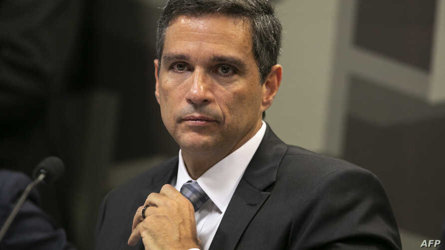 Brazilian Senior banking executive Roberto Campos Neto, who is nominated by Brazilian President Jair Bolsonaro for the presidency of Brazil's Central Bank, gestures during a meeting of the Brazilian Federal Senate Economic Affairs Committee (CAE) in