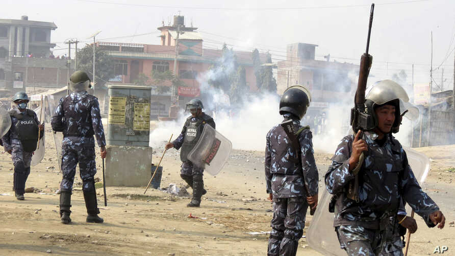 Nepalese policemen use tear gas to disperse ethnic Madhesi protesters in Gaur, a town about 160 kilometers (100 miles) south of Kathmandu, Dec.20, 2015.
