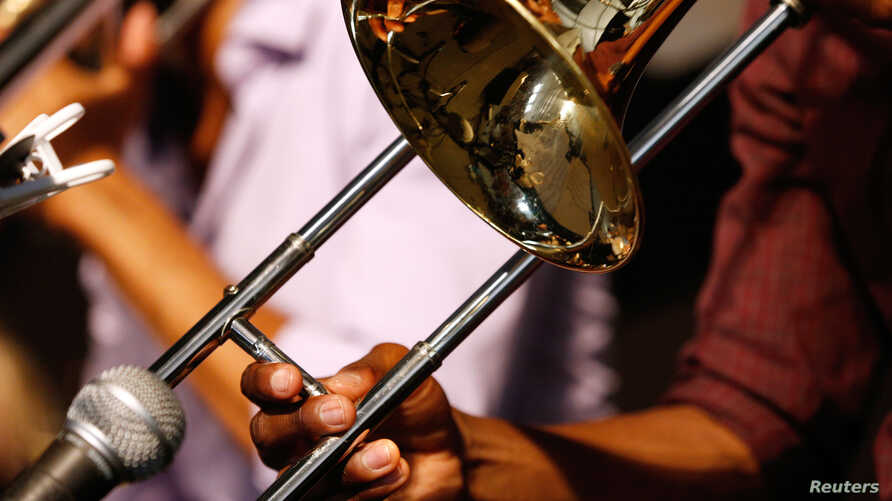 FILE - A musician plays a trombone during the first day of the New Orleans Jazz and Heritage Festival in New Orleans, Louisiana, April 25, 2014.
