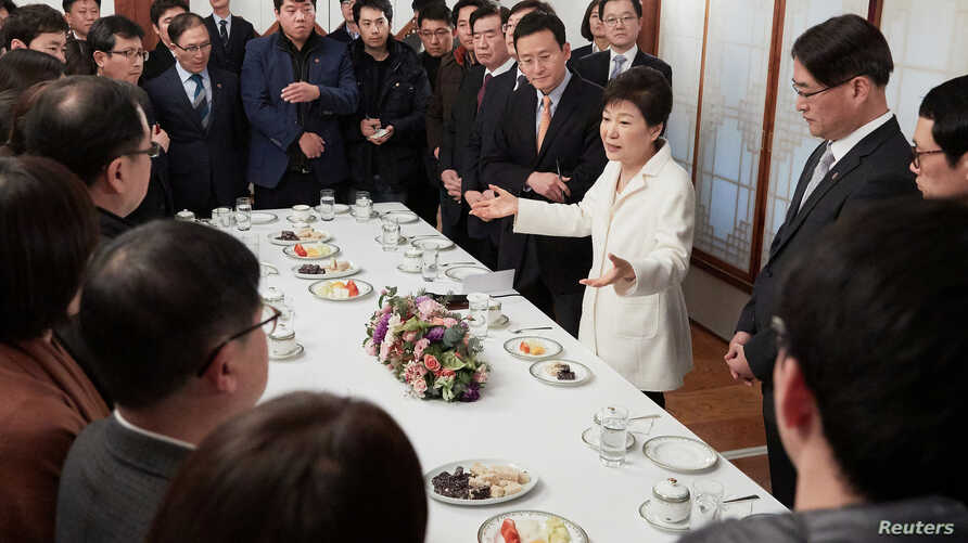 South Korean President Park Geun-hye speaks during a meeting with reporters at the Presidential Blue House in Seoul, South Korea, in this handout picture provided by the Presidential Blue House and released by Yonhap, Jan. 1, 2017.