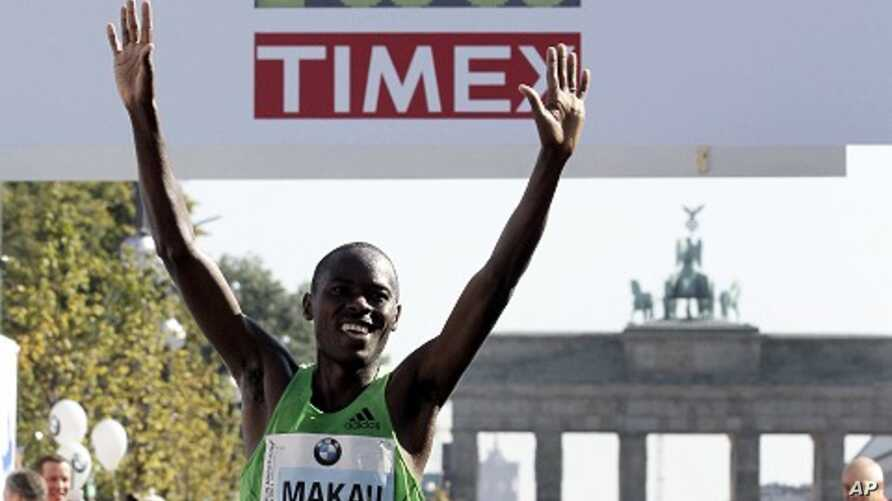 Patrick Makau from Kenya crosses the finish line to win the 38th Berlin Marathon in Berlin, Germany,  in a new world record time of 2 hours, 3 minutes, 38 seconds, September 25, 2011.