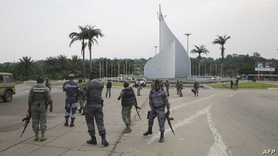 Gabonese gendarmes patrol on the Democracy square in Libreville, Jan. 7, 2018, after a group of soldiers sought to take power in Gabon while the country's ailing president was abroad.