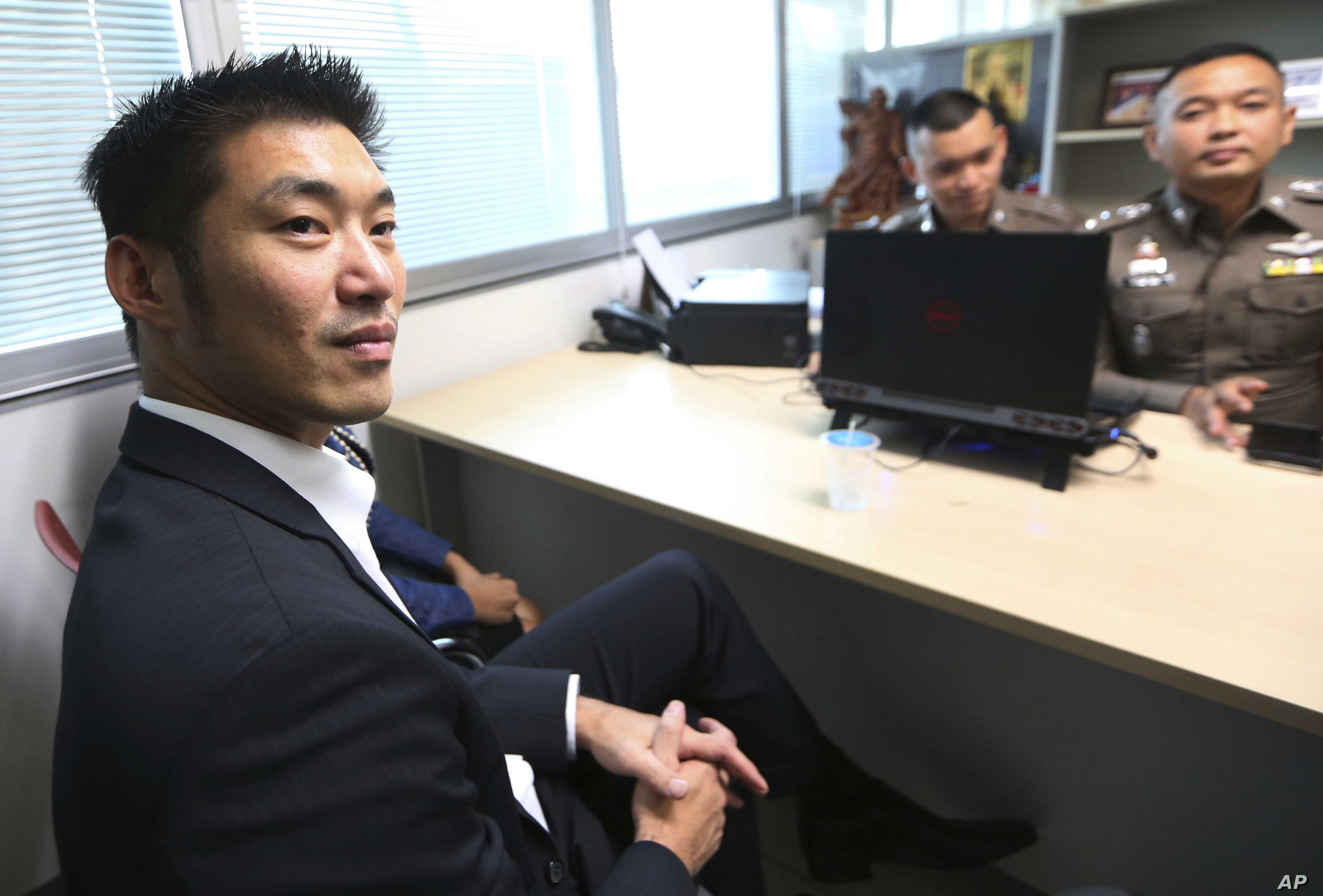 The leader of the political party named Future Forward Party, Thanathorn Juangroongruangkit arrives at the Technology Crime Suppression Division to hear police charges in Bangkok, Thailand, Monday, Sept. 17, 2018.