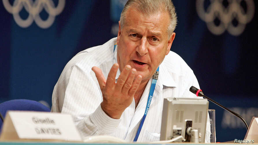 File - Disciplinary spokesman for the International Olympic Committee Francois Carrard - selected August 11, 2015 to chair a group of leading reforms of FIFA's governing body - pauses during a news conference in Athens, Greece.