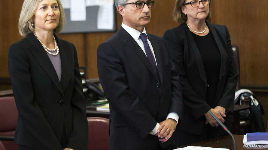 Georges Dirani (C), general counsel for BNP Paribas, appears with his lawyers in New York state court, June 30, 2014. The French bank pleaded guilty to two criminal charges of violating U.S. sanctions laws.