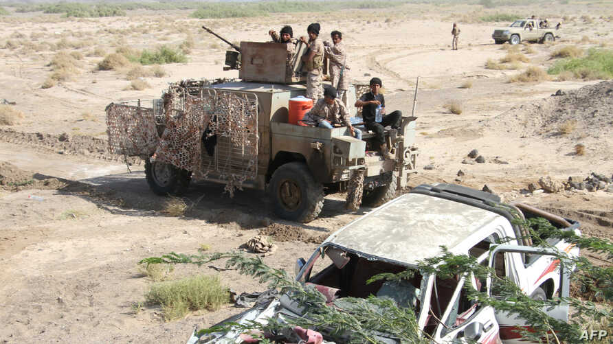 Fighters loyal to the Saudi-backed Yemeni president hold a position during a military operation against Shi'ite Houthi rebels and their allies in the coastal district of Dhubab, Jan. 7, 2017.