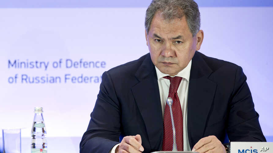 FILE - Russian Defense Minister Sergei Shoigu listens during a security conference in Moscow, May 23, 2014.