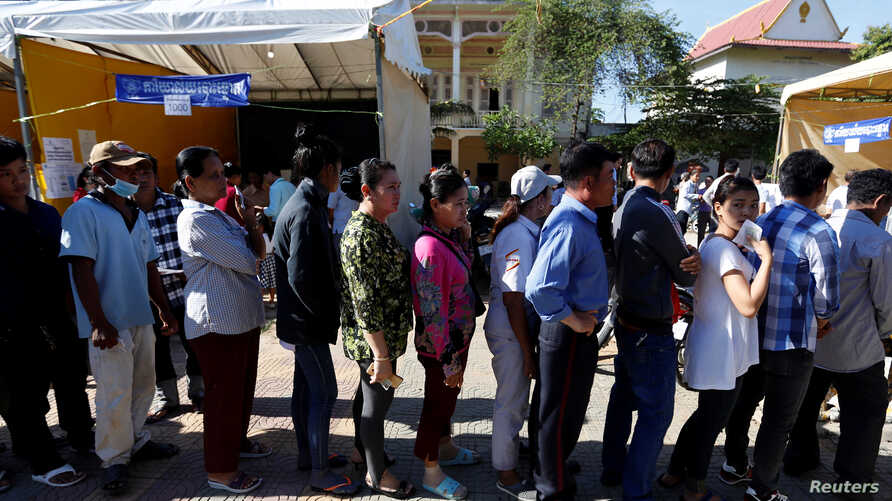People line up to vote during local elections in Phnom Penh, Cambodia, June 4, 2017.