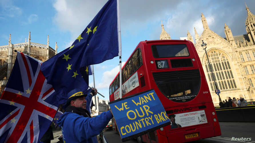 Anti-Brexit protesters demonstrate opposite the Houses of Parliament in London, Britain, January 16, 2018.