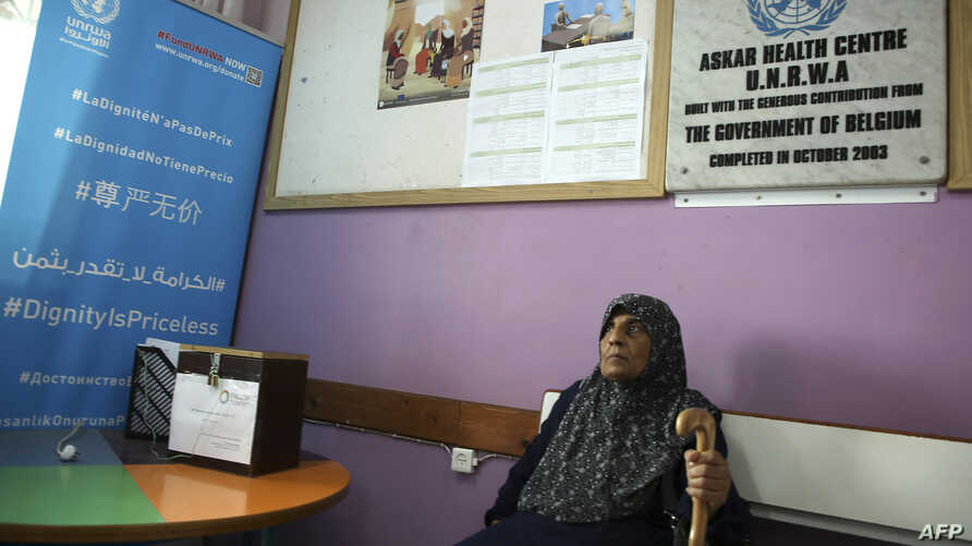 FILE - A refugee waits for a medical check in the UNWRA health center at the Asker refugee camp, near Balatah, east of Nablus, in the occupied West Bank, Sept. 1, 2018.