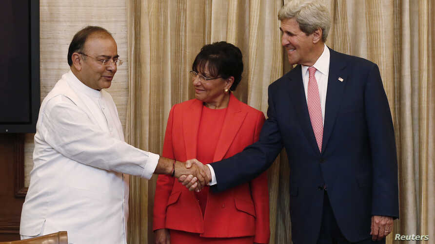 U.S. Secretary of State John Kerry (R) shakes hands with India's Finance Minister Arun Jaitley as U.S. Commerce Secretary Penny Pritzker (C) watches before the start of their meeting in New Delhi, July 31, 2014.