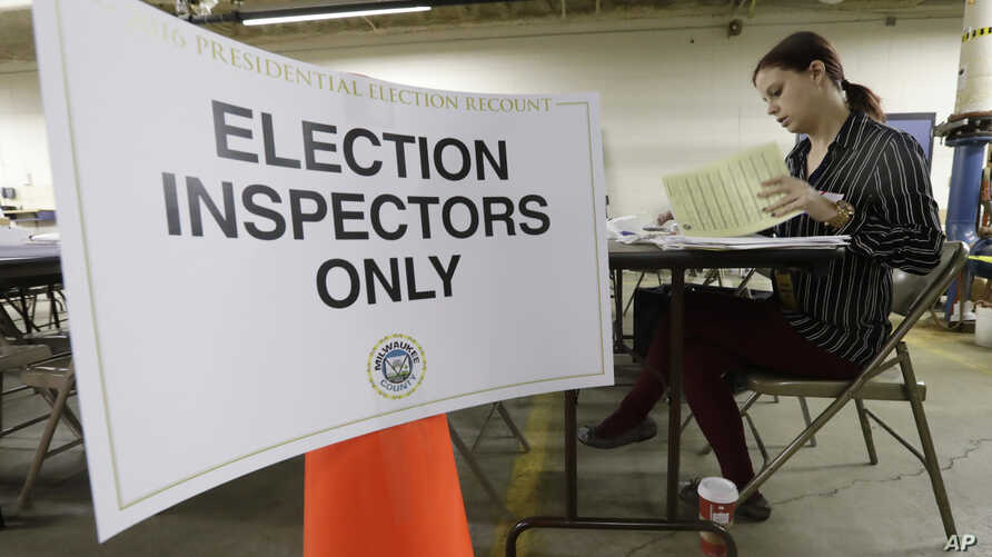 Nicole Kirby looks over results during a statewide presidential election recount Dec. 1, 2016, in Milwaukee.