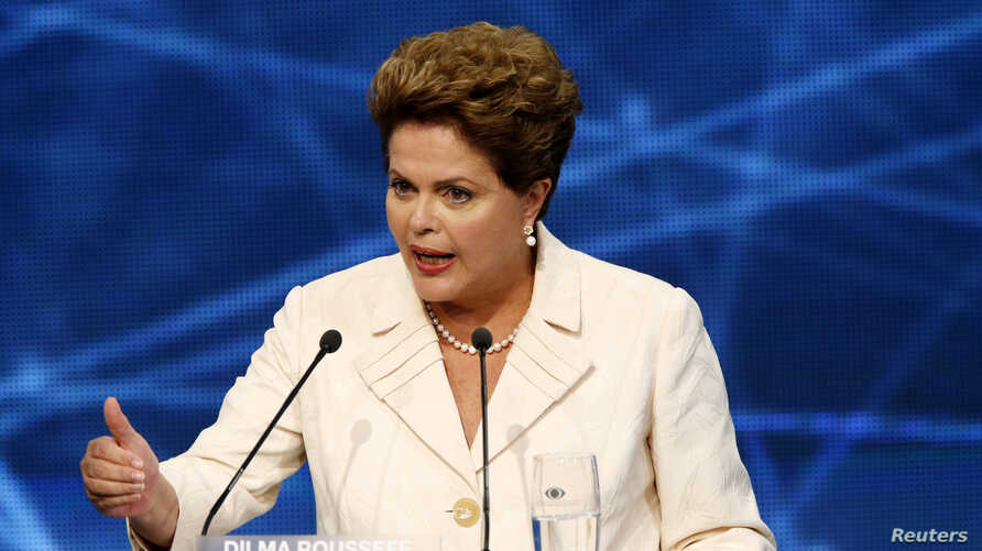 Presidential candidate and Brazilian President Dilma Rousseff of Workers' Party (PT) speaks during the first television debate at the Bandeirantes TV studio in Sao Paulo, Aug. 26, 2014.