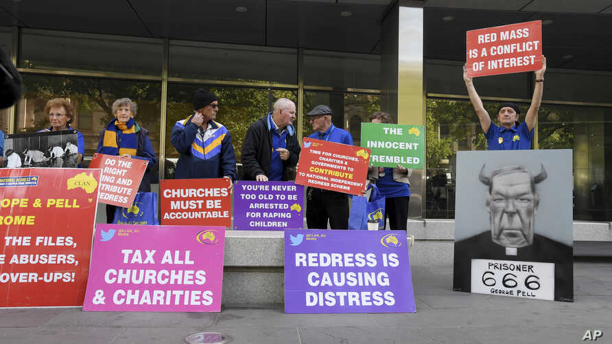 Protesters gather outside the County Court during the sentencing of Cardinal George Pell in Melbourne, Australia, Wednesday, March.13, 2019.