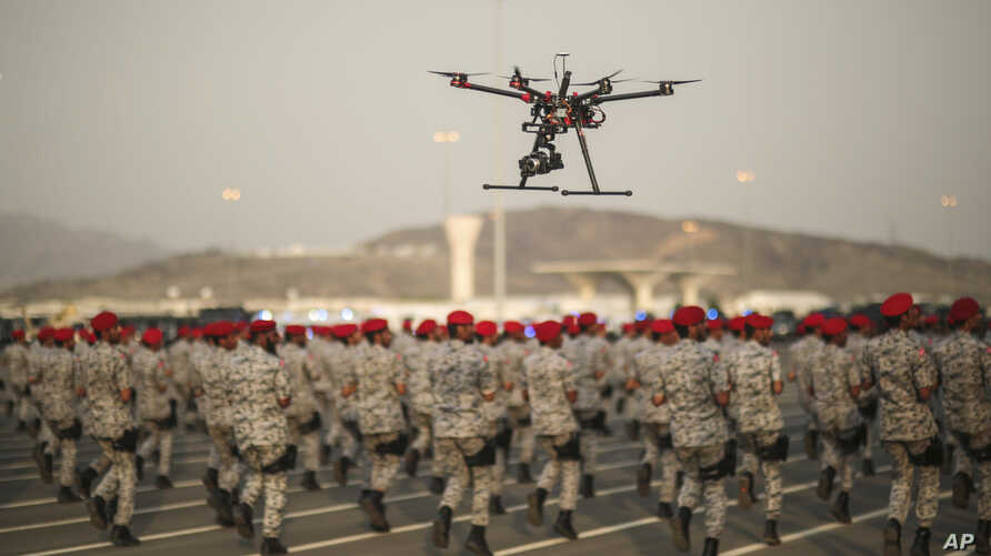 FILE - In this Thursday, Sept. 17, 2015 file photo, a drone is used to record a military parade by Saudi security forces in preparation for the annual Hajj pilgrimage in Mecca, Saudi Arabia. The war in Yemen is costing the Kingdom $200 million a day.