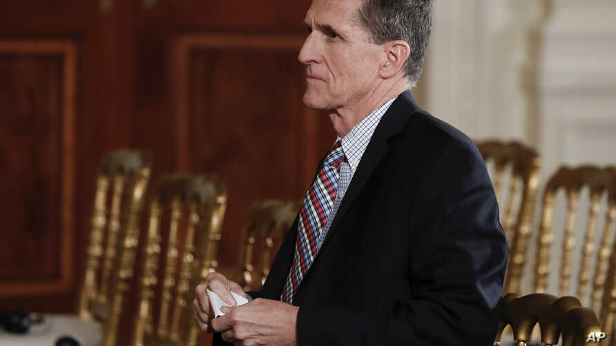 FILE - National Security Adviser Michael Flynn sits before the start of the news conference of President Donald Trump and Japanese Prime Minister Shinzo Abe in the East Room of the White House, Feb. 10, 2017. The House intelligence committee is issui...