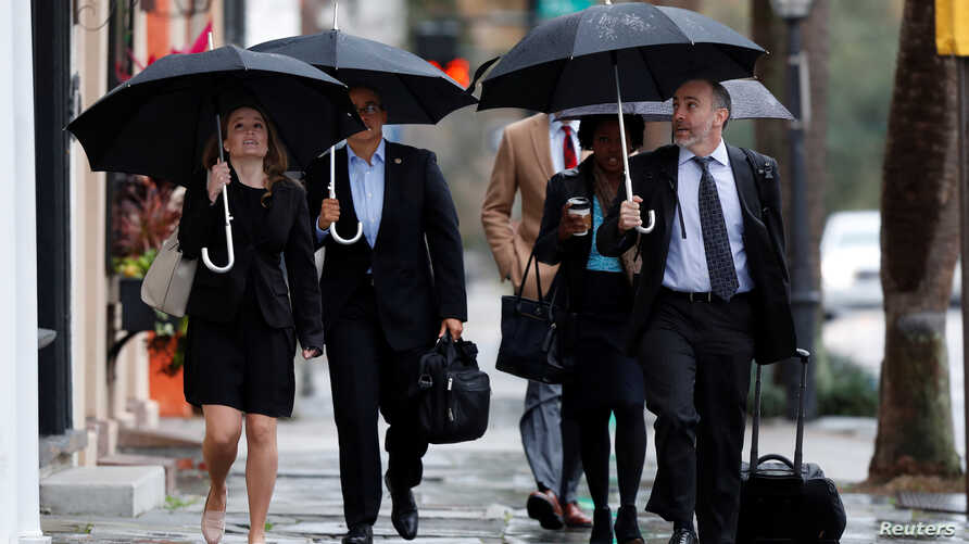 Federal prosecutors arrive for the 4th day of testimony during the sentencing hearing for former North Charleston police officer Michael Slager in Charleston, South Carolina, U.S., December 7, 2017.