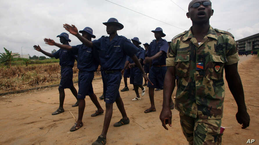 FILE - Former combatants drawn from both sides of Ivory's Coast civil war march during training exercises to prepare them to join the new national army, in the Yopougon district of Abidjan, Ivory Coast,  July 26, 2011.