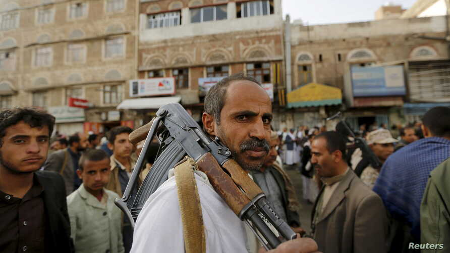 An armed Houthi follower attends a rally against Saudi-led air strikes in Sanaa, June 14, 2015.