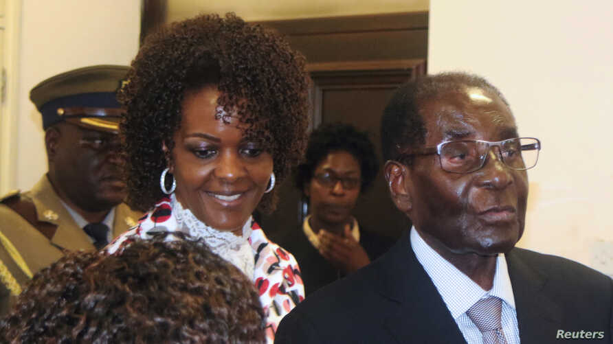 FILE - President Robert Mugabe and his wife Grace arrive to chair ZANU PF's Politburo meeting at the party headquarters in Harare, Feb. 15, 2017.