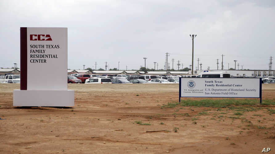 FILE - Signs at the entrance to the South Texas Family Residential Center in Dilley, Texas, June 30, 2015. Lawyers for the mother of a toddler who died several weeks after being released from the nation's largest family detention center have filed a