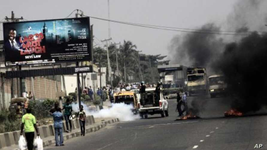 Police fire tear gas on protester on a major road in commercial capital during a fuel subsidy protest in Lagos, Nigeria, January 3, 2012.