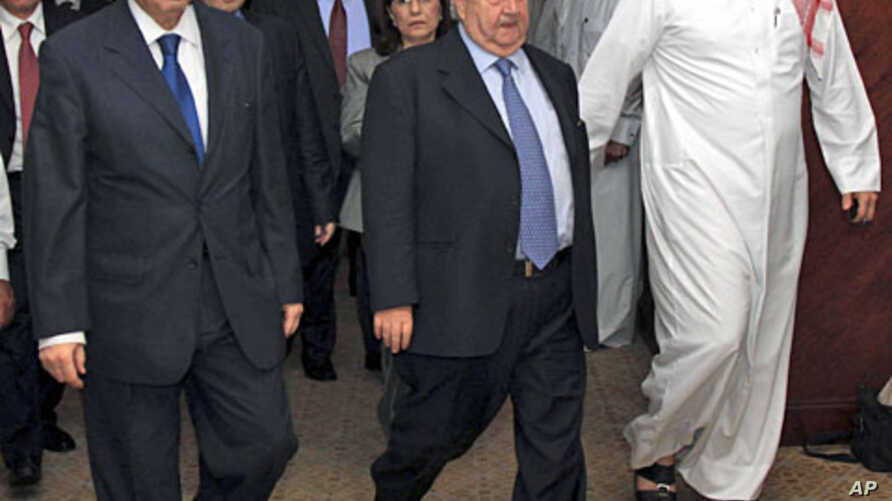 A handout photograph from Syria's national news agency shows Syria's delegation headed by FM Walid Moualem (C), Bouthaina Shaaban (behind Moualem), a political advisor to President Bashar al-Assad, and ambassador to the Arab League Yousef al-Ahmed (L