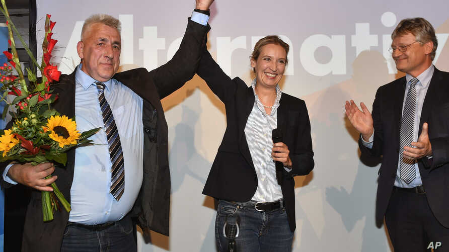 AfD top candidate Alice Weidel, center, gets flowers during the election party of the nationalist 'Alternative for Germany', AfD, in Berlin, Germany,  Sept. 24, 2017.