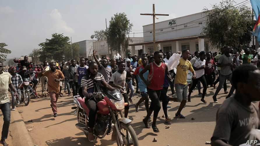 Several hundreds of people demonstrate, Dec. 27, 2018, in Beni, Democratic Republic of Congo, to protest the postponement, announced the day before by the Congolese national committee, of the general elections in this area because of the Ebola outbre...