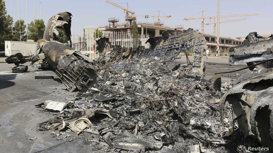A wreckage of a burnt aircraft is pictured after a shelling at Tripoli International Airport in Tripoli, Libya, July 21, 2014.