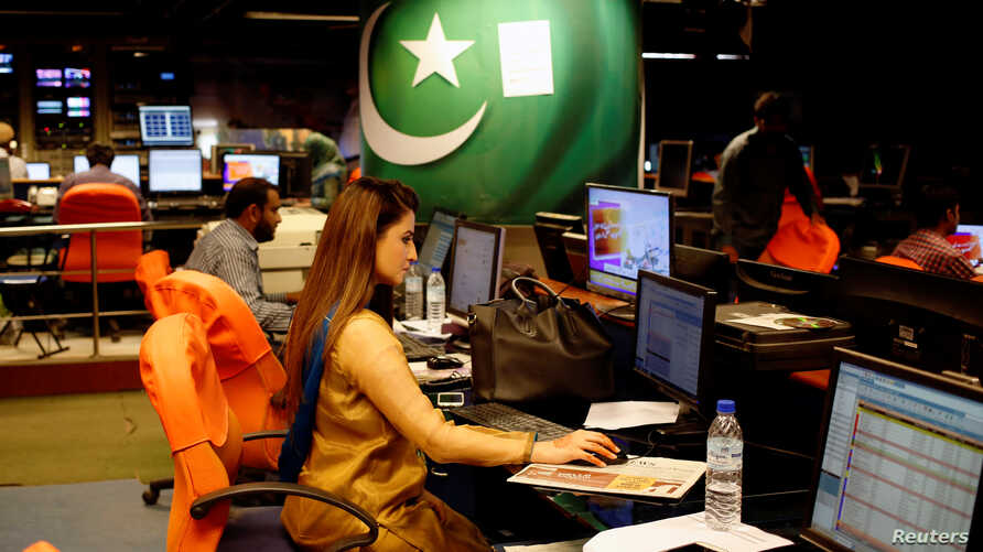 An employee works at the control room of the Geo News television channel in Karachi, Pakistan, April 11, 2018.