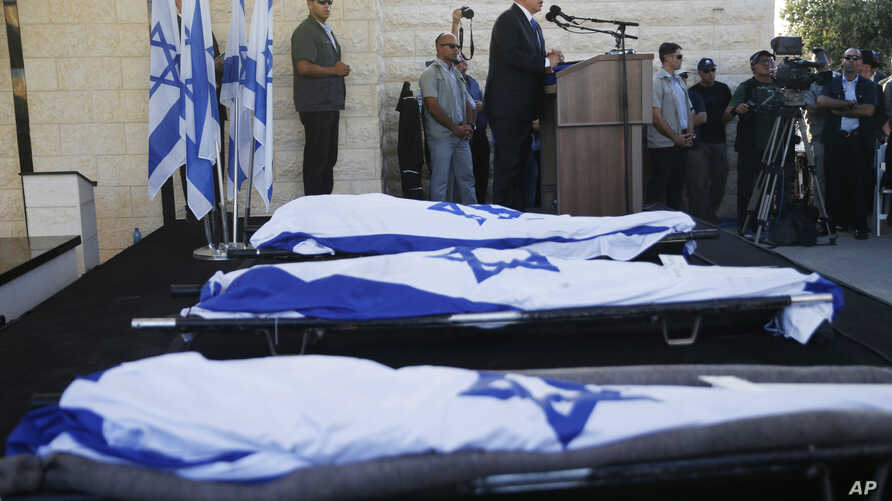 Israeli Prime Minister Benjamin Netanyahu eulogizes three Israeli teens who were abducted and killed in the West Bank during their joint funeral in Modiin, July 1, 2014.
