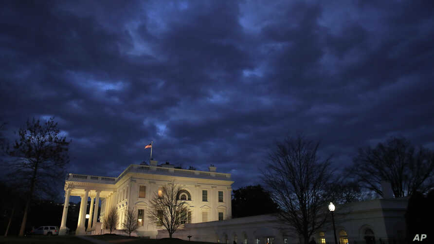 In this Jan. 8, 2019, photo, clouds roll over the White House, Jan. 8, 2019, in Washington. Just 21 of the roughly 80 people who help care for the White House - from butlers to electricians to chefs - are reporting to work. The rest have been furloug