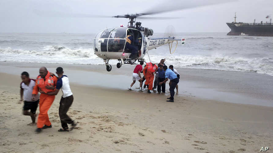 Indian Coast Guards lead crew members to safety on a rescue mission on the Indian ship Pratibha Cauvery which ran aground due to strong winds on the Bay of Bengal coast, off Chennai, India, November 1, 2012.