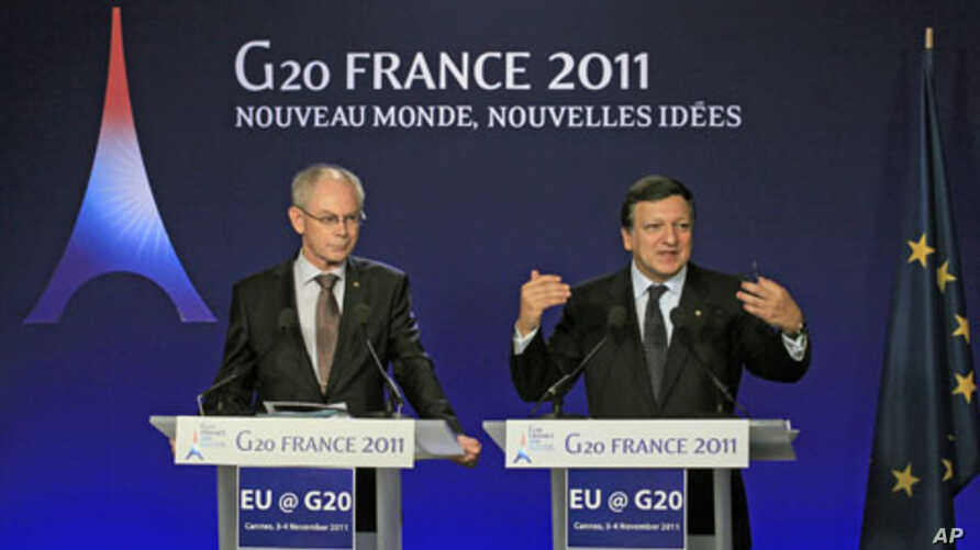 European Commission President Jose Manuel Barroso (r) and European Council President Herman Van Rompuy (l) during a news conference on the second day of the G20 Summit in Cannes, France, November 4, 2011.