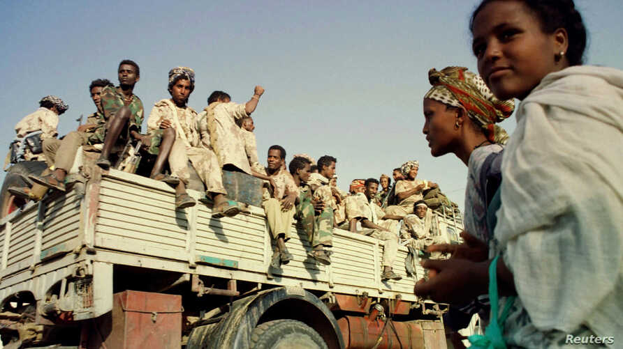Eritrean soldiers celebrate the country's ninth anniversary of independence from Ethiopia 23 May.