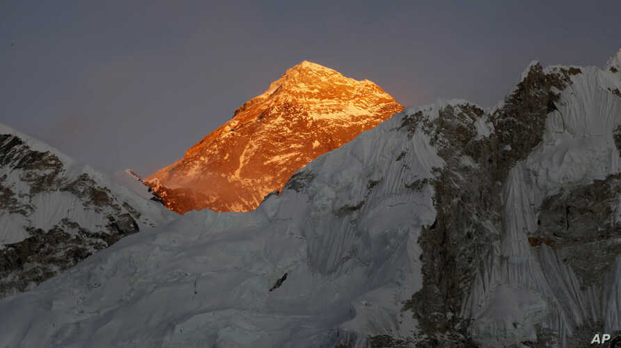 FILE - In this Nov. 12, 2015, file photo, Mt. Everest is seen from the way to Kalapatthar in Nepal. Some climbers attempting to scale Mount Everest during the upcoming spring climbing season will be strapped with a GPS device to locate them in case t