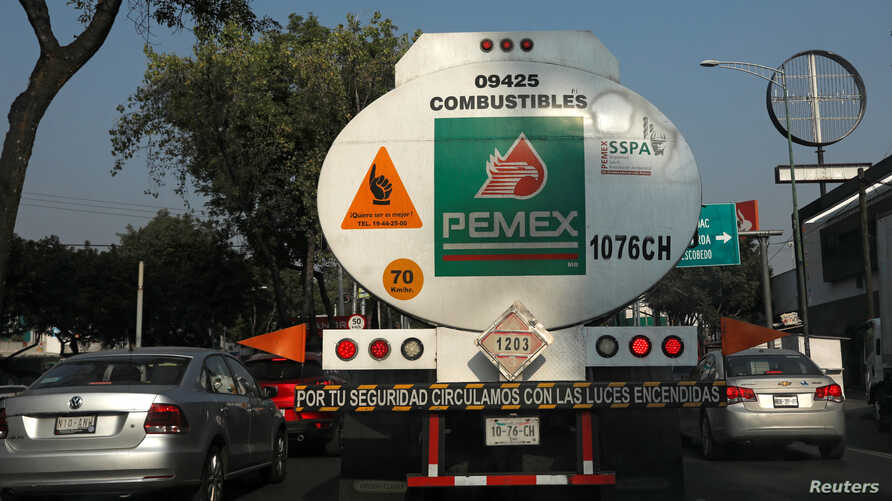 A tanker truck transporting fuel is pictured along the streets en route to a gas station, in Mexico City, Mexico, Jan. 15, 2019.