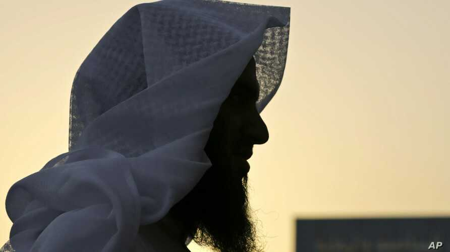 FILE - Former Islamic militant, 30-year-old Badr al-Enezi, stands in a courtyard at the Mohammed bin Nayef Center for Advice, Counseling and Care, as the rehab center is formally known, in Riyadh, Saudi Arabia, April 26, 2015.