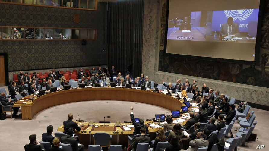 The U.N. Security Council votes on a resolution concerning Somalia, March 23, 2017. President Mohamed Abdullahi Mohamed addressed the council via a video link from Nairobi.