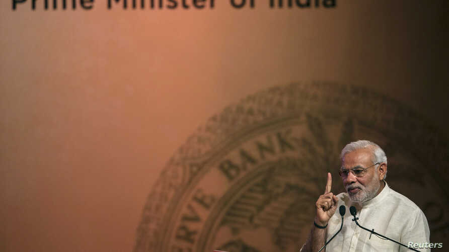 FILE - India's Prime Minister Narendra Modi speaks during an event on financial inclusion in Mumbai, April 2, 2015. Modi will arrive in Tehran Sunday for talks with Iranian President Hassan Rouhani.