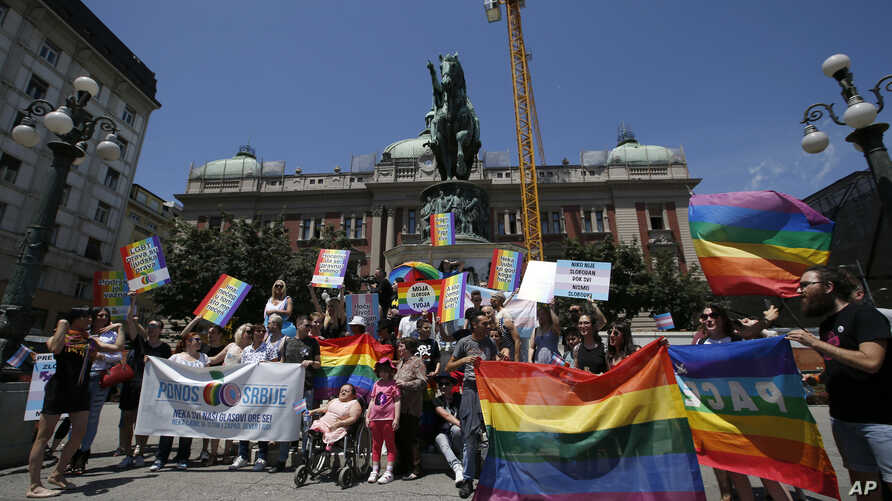 People dance and wave peace flags at a gay pride march in Belgrade, Serbia, June 24, 2017. Serbia's first openly gay and female prime minister Ana Brnabic is set to take office next week.