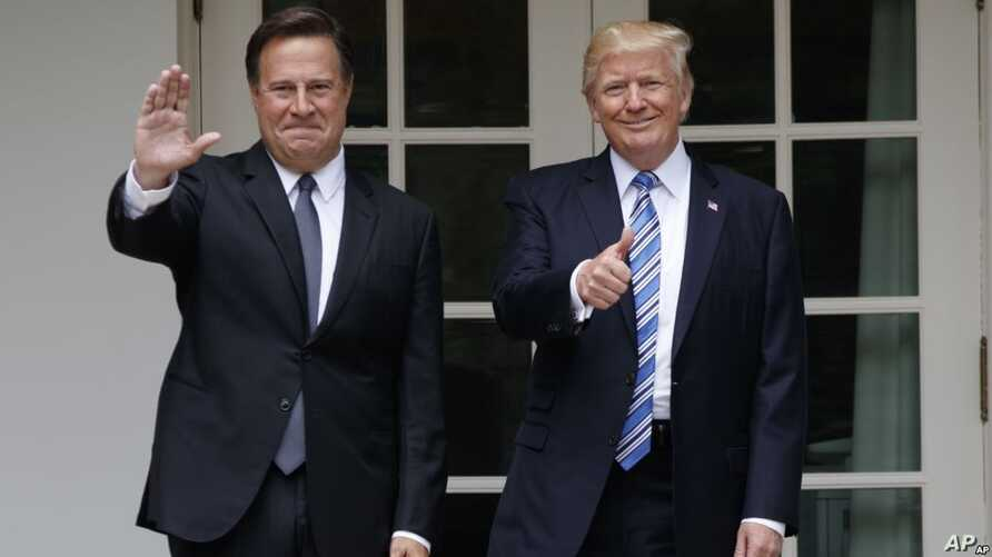 President Donald Trump stands with Panamanian President Juan Carlos Varela at the White House in Washington, June 19, 2017.