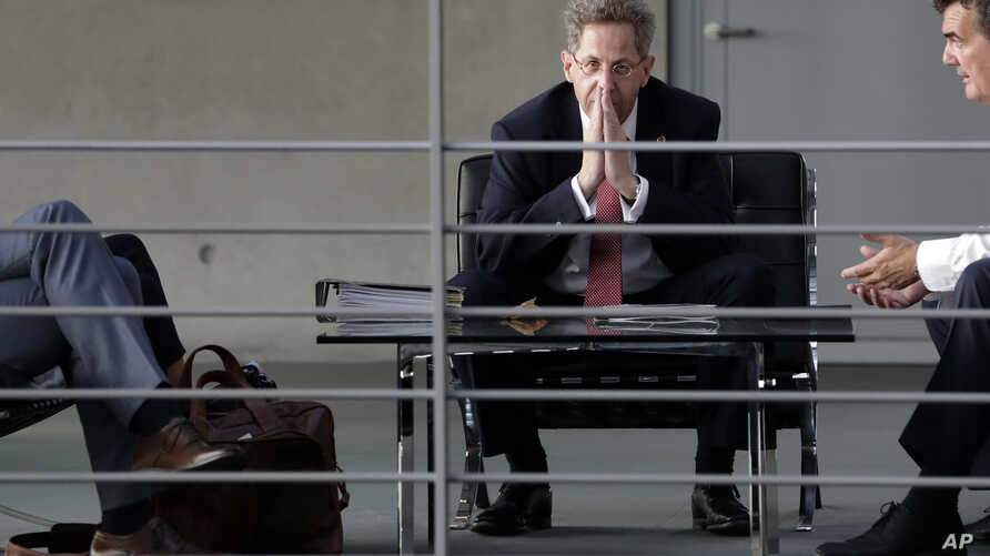 FILE - Hans-Georg Maassen, head of the German Federal Office for the Protection of the Constitution, waits for the beginning of a hearing at the home affairs committee of the German federal parliament, Bundestag, in Berlin, Germany, Sept. 12, 2018.