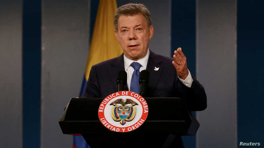 Colombia's President Juan Manuel Santos talks during a news conference after a meeting with former Colombian President Alvaro Uribe at Narino Palace in Bogota, Colombia, Oct. 5, 2016.