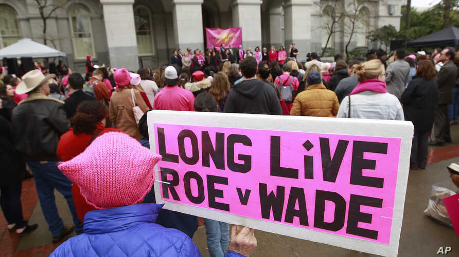 Pat Thompson displayed a sign supporting Roe v. Wade at a rally, held by Planned Parenthood, commemorating the 45th anniversary of the landmark Supreme Court decision at the Capitol, Jan. 22, 2018, in Sacramento, California.