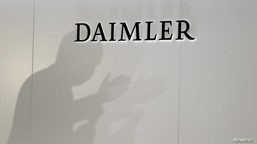 The Daimler logo is seen during a press conference on the second day of the Paris auto show, Oct. 3, 2018.